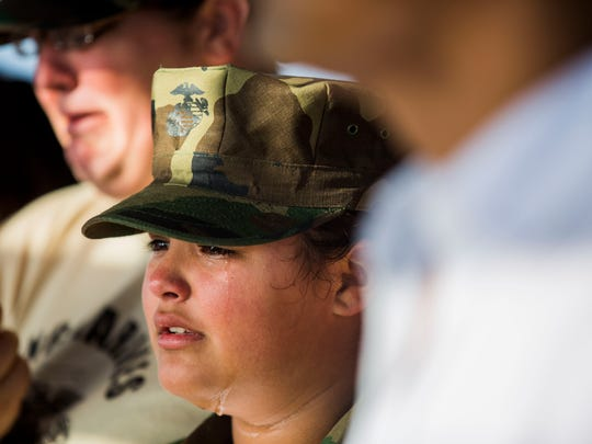 Selena Barlow, 11, mourns the loss of her cousin, Naples Marine Austin Ruiz, during a Celebration of Life service at Lovers Key State Park on Sunday, Jan. 22, 2017.