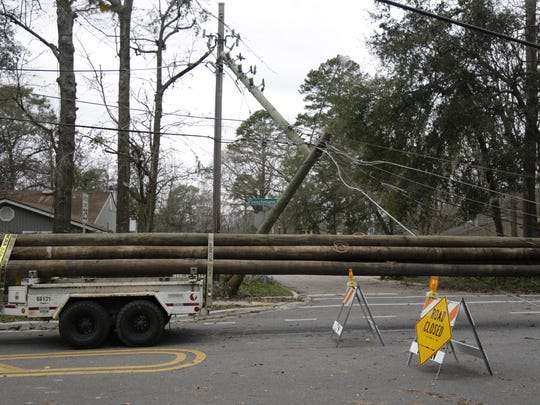 On Monday morning new poles arrive on Fleischmann Road to replace the ones destroyed in Sunday's storm.