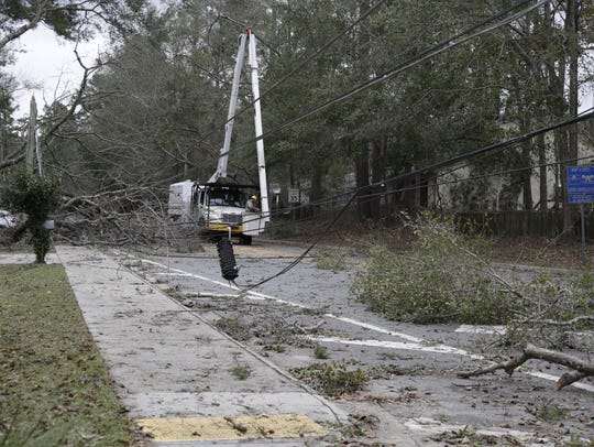 Crews are working to clear downed trees and power lines