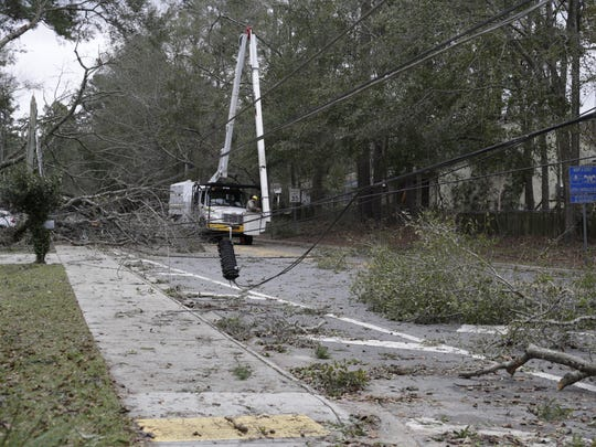 Crews are working to clear downed trees and power lines from Fleischmann Road after Sunday's storm.