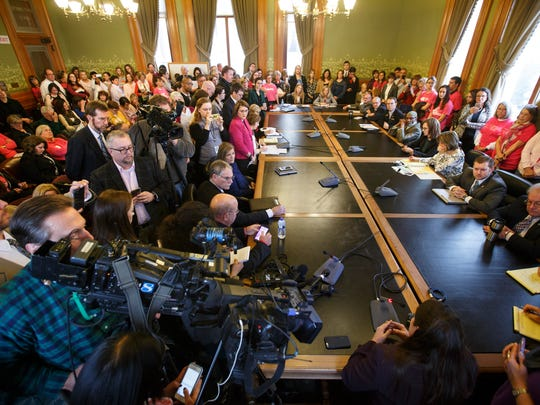 Planned Parenthood supporters and opponents pack an overflowing Iowa Senate Committee room for hearing on bill to defund Planned Parenthood Tuesday, Jan. 24, 2017.