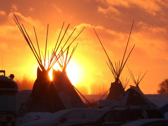 The sun sets on Dec. 5 at the Oceti Sakowin campground near Cannon Ball, N.D. Demonstrators against the Dakota Access Pipeline have used the campground as their headquarters.