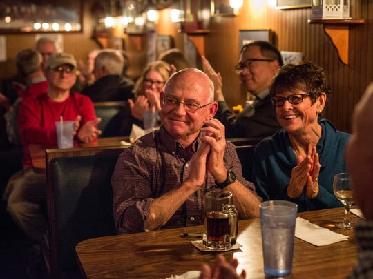 George and Julia Sheele, of St. Clair, clap during the Bootlegger Balladeer Wednesday, Jan. 25, 2017 at LaCroix's Riverside Pub in St. Clair.