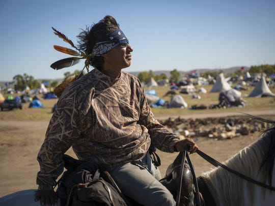 Frank Archambault of the Standing Rock Sioux provides security at Oceti Sakowin Camp near the Standing Rock Reservation on Sept. 29 near Cannon Ball, N.D. Frank Archambault of the Standing Rock Sioux provides security at Oceti Sakowin Camp near the Standing Rock Reservation Thursday, Sept. 29, 2016, near Cannon Ball, N.D.