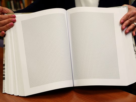 "A spread from the book ""And Every Single One Was Someone"" which has the word ""Jew"" printed six million times for those killed in the Holocaust. The book is at at the Holocaust and Human Rights Education Center in White Plains."