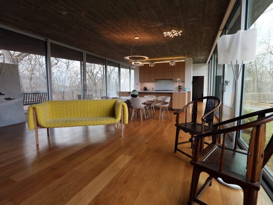 Living room and kitchen of a modern concrete and glass