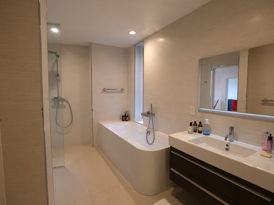 This master ensuite in Rye features one large sink,