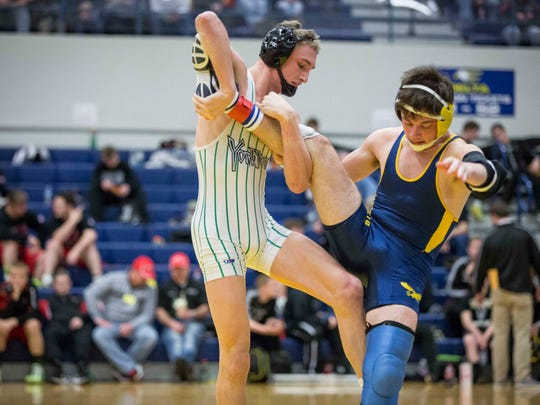 Christian Hunt with Yorktown grapples with Delta's