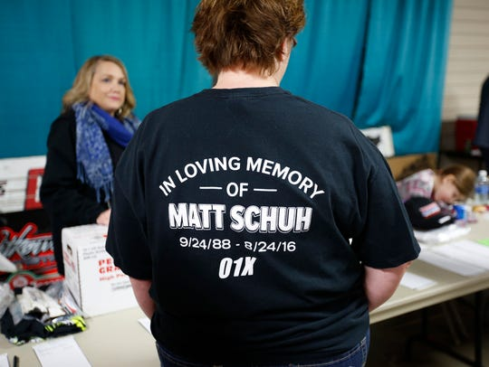 A member of the racing community wears a T-shirt in