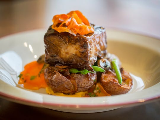 Short rib with bordelaise is served with smashed potatoes,
