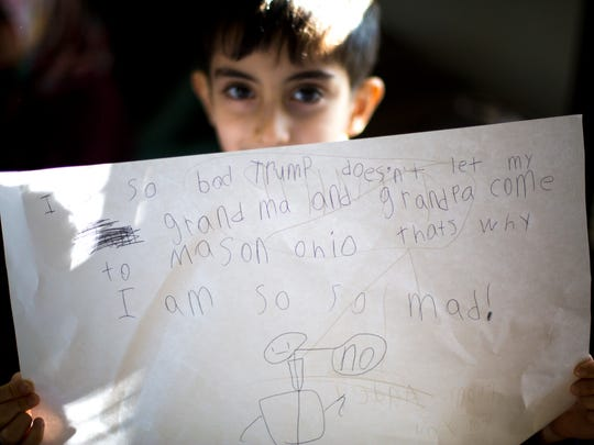 "A picture drawn by Nakisa Azari's 6-year-old son, Aadel shows President Donald Trump saying ""No,"" with the words, ""It's so bad Trump doesn't let my grandma and grandpa come to Mason Ohio, that's why I am so mad.""   The parents of Azari, 37, of Mason, were supposed to land in the U.S. Saturday from Iran, but now cannot come over because of President Donald Trump's executive order on immigration. ""She's just a grandma,"" Nakisa said of her mother. Nakisa was planning to go back to school to be an art teacher, and her mother, who had her paperwork for a greencard, was planning to help her and her husband with the kids while she was in school. She was also looking forward to her father working with her son in math."