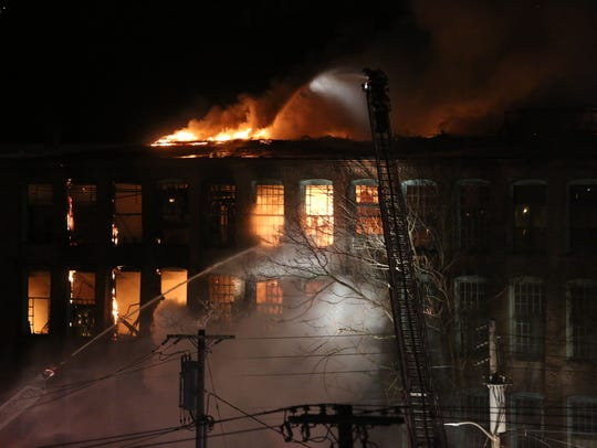 Yonkers firefighters work at the scene of a General