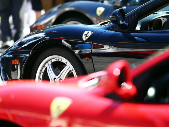 Ferraris line 5th Avenue South during the 12th Annual Cars on 5th show in Naples on Saturday, Feb. 13, 2016.