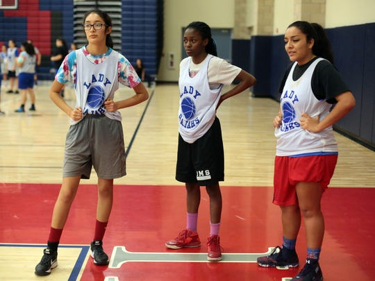 (From the left) Indio varsity basketball team members Yukiko Lopez, Emoni Miller and  Muuny Rosales (CQ) at practice on Thursday, February 2, 2017 in Indio.