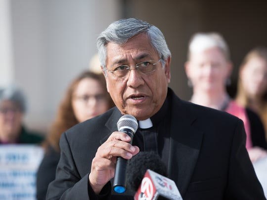 Deacon Lou Roman, of St. Genevieve's Catholic Church, spoke to the gathering outside the Doña Ana County Sheriffs Office Friday, February 3, 2017.