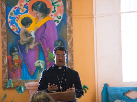 """Catholic Bishop Oscar Cantú opens the interfaith service """"Welcoming the Stranger,"""" at St. Albert the Great Newman Center, Friday February 3, 2017. The Service brought together people of different faiths to discuss the new administrations stances toward refugees and have an all inclusive prayer service."""