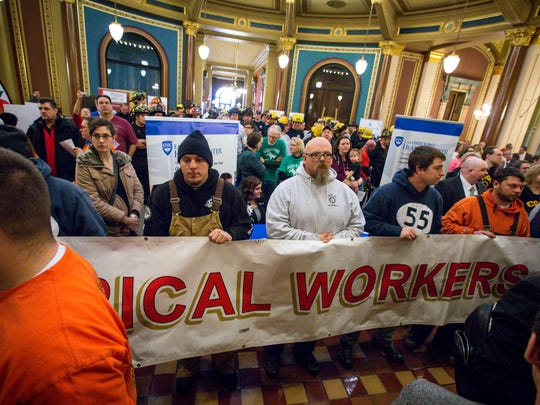 Union workers and supporters gathered at the Iowa Capitol