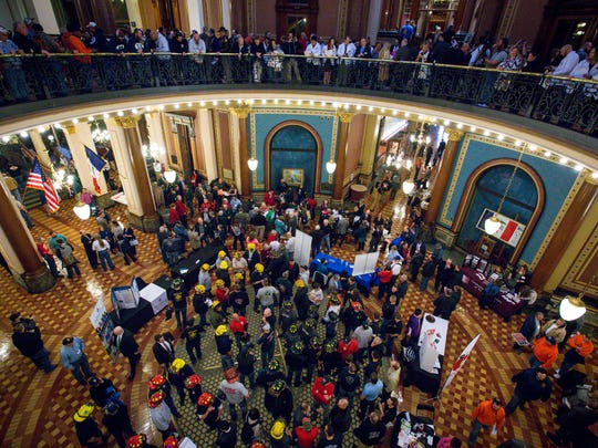Union workers gather at the Iowa Capitol during a labor rally in the Rotunda on Tuesday, Feb. 7, 2017, in Des Moines, Iowa.