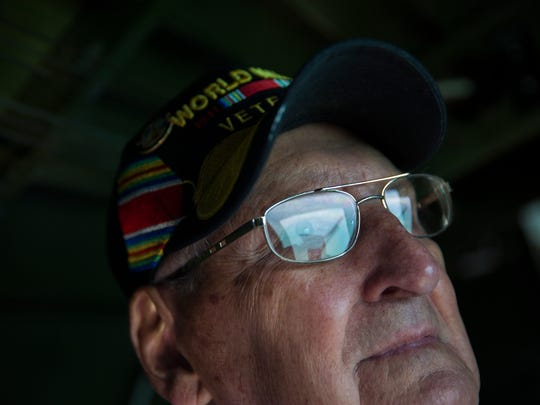 """Vernon """"Bo"""" Sigo, 92, looks out of the window in the back of a Boeing B-17 Flying Fortress during a flight from Marathon, Fla. to the Naples Municipal Airport in East Naples on Thursday, February 2. This was the first time Sigo stepped foot on a B-17 since he came home from war on October 4, 1945. Sigo was a navigator in the 49th bomb squadron in the second bomb group."""