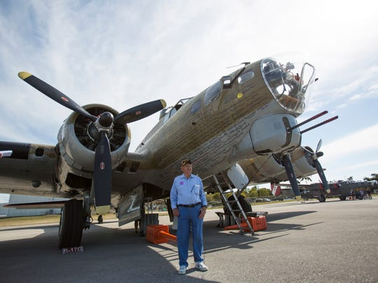 """Vernon """"Bo"""" Sigo, 92, stands in front of the Boeing B-17 Flying Fortress after his flight from Marathon, Fla. to the Naples Municipal Airport in East Naples on Thursday, February 2, 2017. This was the first time Sigo stepped foot on a B-17 since he came home from war on October 4, 1945."""