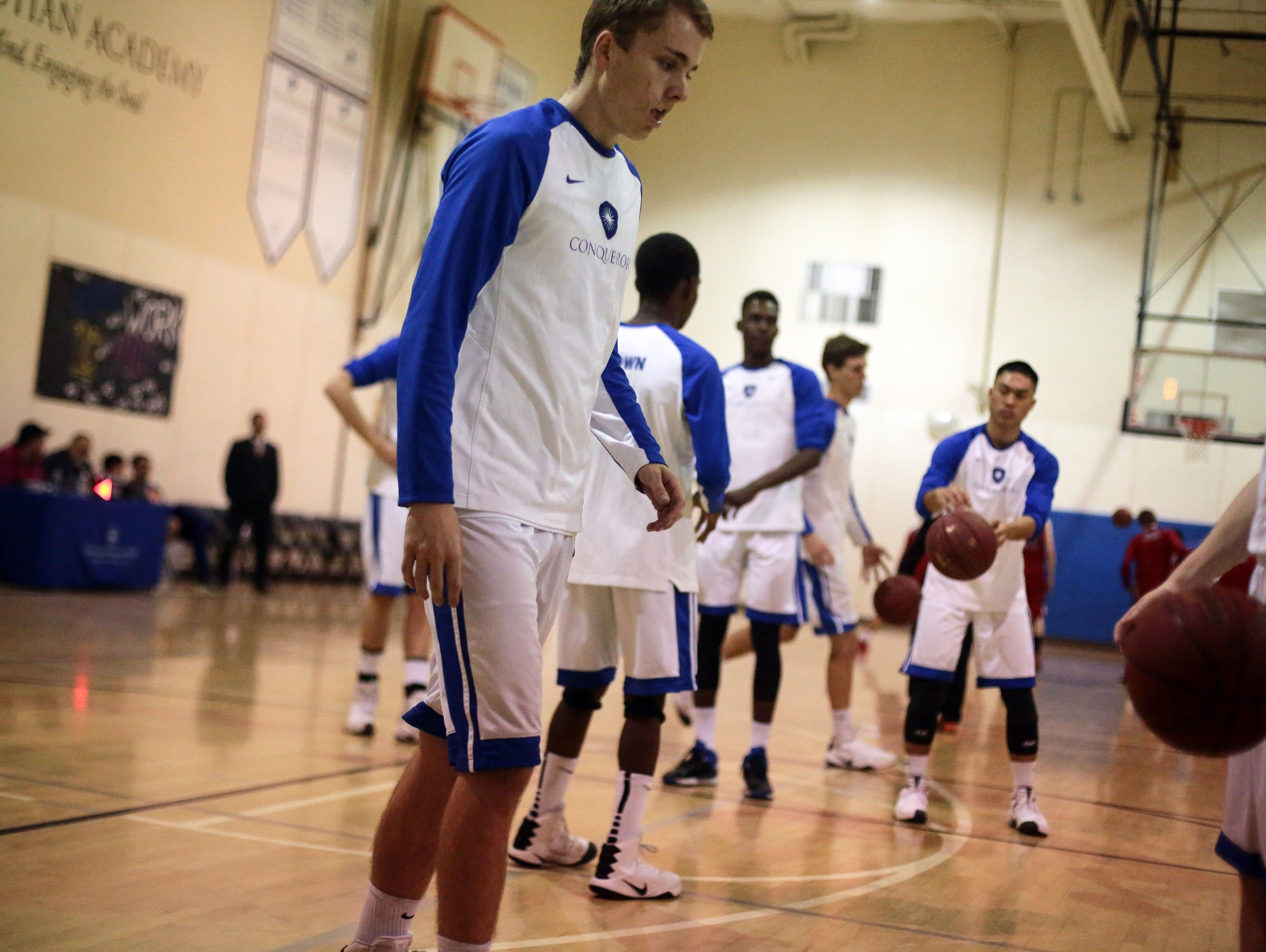 Desert Christian forward Will Whitaker warms up with his team on Wednesday, February 7, 2017 before their game with Palm Valley.