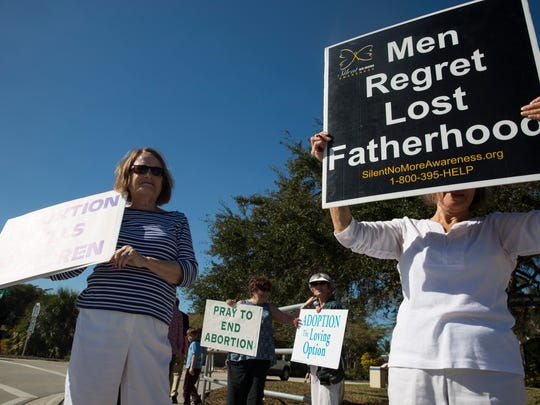 Mary Dunne, left, and Rose Sharp, right, along with many other pro-life supporters, rally in front of Planned Parenthood as they wave at passing cars on Goodlette-Frank Road Saturday, Feb. 11, 2017 in Naples. The rally is apart of a nationwide effort to call on Congress and President Trump to strip Planned Parenthood of all federal funding.