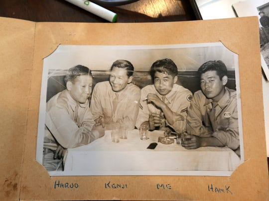 Julie Shiroishi shows a photo of her father, Tom Shiroishi, third from left, at her Beacon home Feb. 13, 2017. The photo was taken after he enlisted in the army. Before then he was in an internment camp for Japanese-Americans in California at the start of World War II.