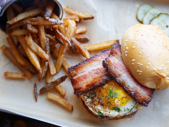 The Brewer's Burger with braised bacon, fried egg,