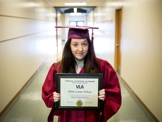 Robin Verhoye, 19, poses with her high school diploma