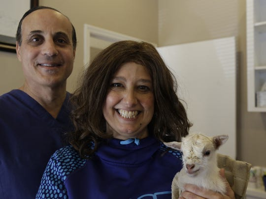 Jodi Martinez has stage four kidney cancer. After her doctor dismissed the idea of medical marijuana treatments, Martinez sought a second opinion from Dr. Mark Moore. Here they pose with a baby goat Martinez is raising.