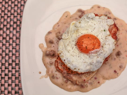 The fried chicken biscuits and gravy prepared by the chefs at Fortun's Kitchen and Bar in La Quinta on Thursday, February 9, 2017.