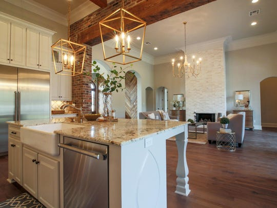 The beautiful kitchen includes top of the line finishes