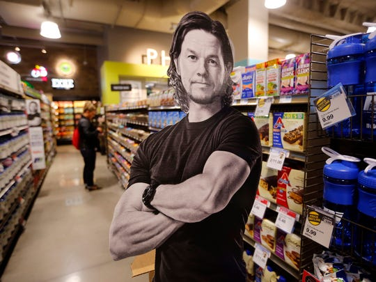 A cutout of Mark Wahlberg makes an appearance at the the opening of the new downtown HyVee store Tuesday, Feb. 28, 2017.