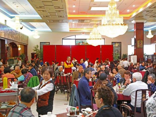 The Sunday morning rush takes place at Mekong Palace.