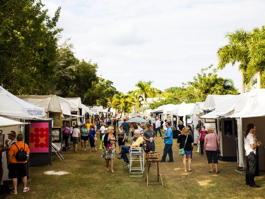 Attendees walk around the art displays during the Bonita Springs National Art Festival on Jan. 14.