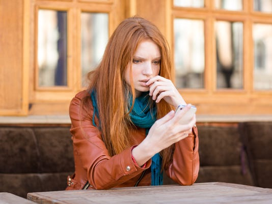 Embarrassed shoked lady reading message in mobile phone