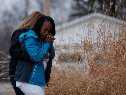 Katrina Johnson cries Thursday, March 2, 2017 at the site where her son, Kedarie Johnson, 16, was found murdered one year ago in an alley in Burlington, Iowa.