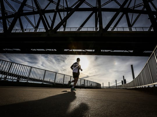 A runner makes his way up the circular path to the