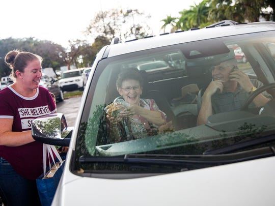 Kari Murphy, left, hands out homemade sandwiches to Harvey and Rosanne Dutkewich of Manitoba, Canada as evacuees wait out the brush fires at Golden Gate Community Center on Tuesday, March 7, 2017.