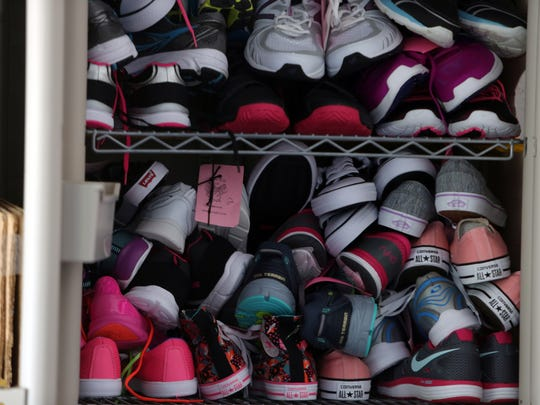 New pairs of sneakers fill up Laces of Love co-founder's Jeanne Nealon's Naples home's garage.  The nonprofit receives donations from other organizations and distributes the new shoes every school year to children in need in Collier and Lee counties.