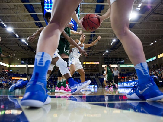 FGCU's Mikala McGhee, center, calls for an inbounds pass in the second half of action during the semifinal game of the Atlantic Sun tournament at Alico Arena Wednesday, March 8, 2017 in Estero. FGCU would win 68-64 advancing to the Atlantic Sun Championship Game.