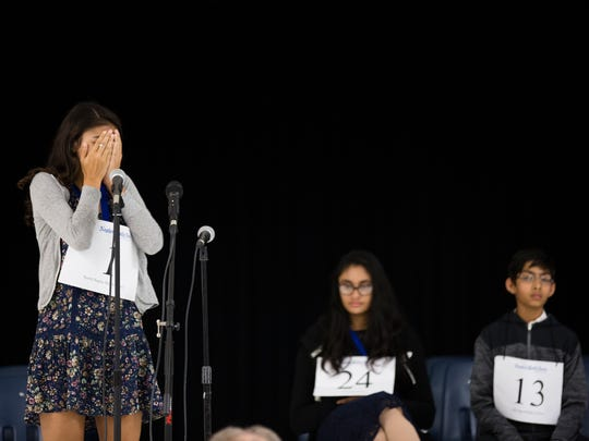 Surya Dodia, a student at North Naples Middle School, holds her hands to her face after spelling the championship word correctly and winning the final round of the Collier/Lee 2017 Spelling Bee at North Naples Middle School in North Naples on Thursday, March 9, 2017. The spelling bee went for 16 rounds.