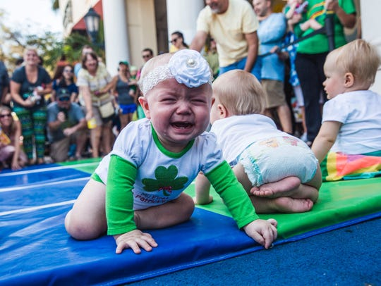 Babies race in the leprechaun races at Miromar Outlets