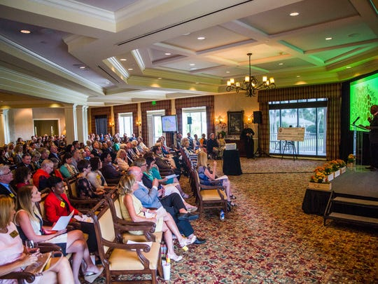 Attendees listen to the grant distribution ceremony put on by the Naples Children & Education Foundation, sponsors of the Naples Winter Wine Festival, on Monday, March 13, 2017, at the Bay Colony Club in Naples. NCEF awarded $12.25 million to 34 charities.