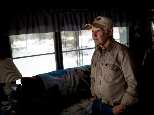 Bob Putze looks out the window of his home as he watches dozens of birds fly to and from his feeders Tuesday, March 14, 2017 in Clyde Township. Putze has been without power since March 8. Putze heats his home with a wood stove and purchased a rotary phone to use until power is restored. As of Tuesday morning, DTE Energy reported power had been restored to 793,000 of 800,000 customers.