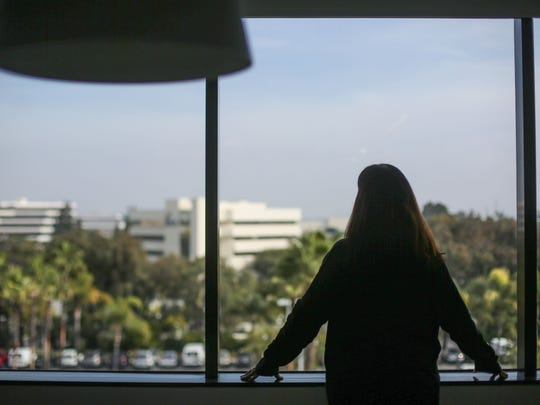 Kim, the mother of a Desert Sands Unified student who was molested by Robert Keith Bryan, is photographed at her lawyer's office in February 2017.