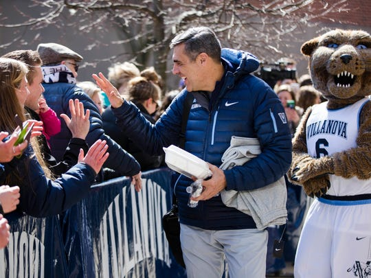 Villanova NCAA college basketball head coach Jay Wright talks to fans before boarding a bus as the team departs Villanova, Pa., on Monday, March 13, 2017, for a game in the first round of the NCAA Tournament, in Buffalo, N.Y. Teams had to contend with a major snowstorm to arrive in time and get a practice in on Wednesday. Play begins Thursday at Key Bank Center.