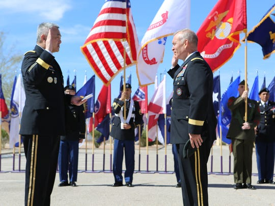 Army Lt. Gen. Michael K. Nagata, left, director of the Directorate of Strategic Operational Planning at the National Counterterrorism Center, re-enlists Maj. Gen. Kurt S. Crytzer during his promotion ceremony on March 2.