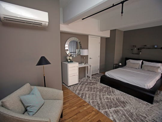 A view of a loft bedroom in a furnished unit at Uno in Yonkers.