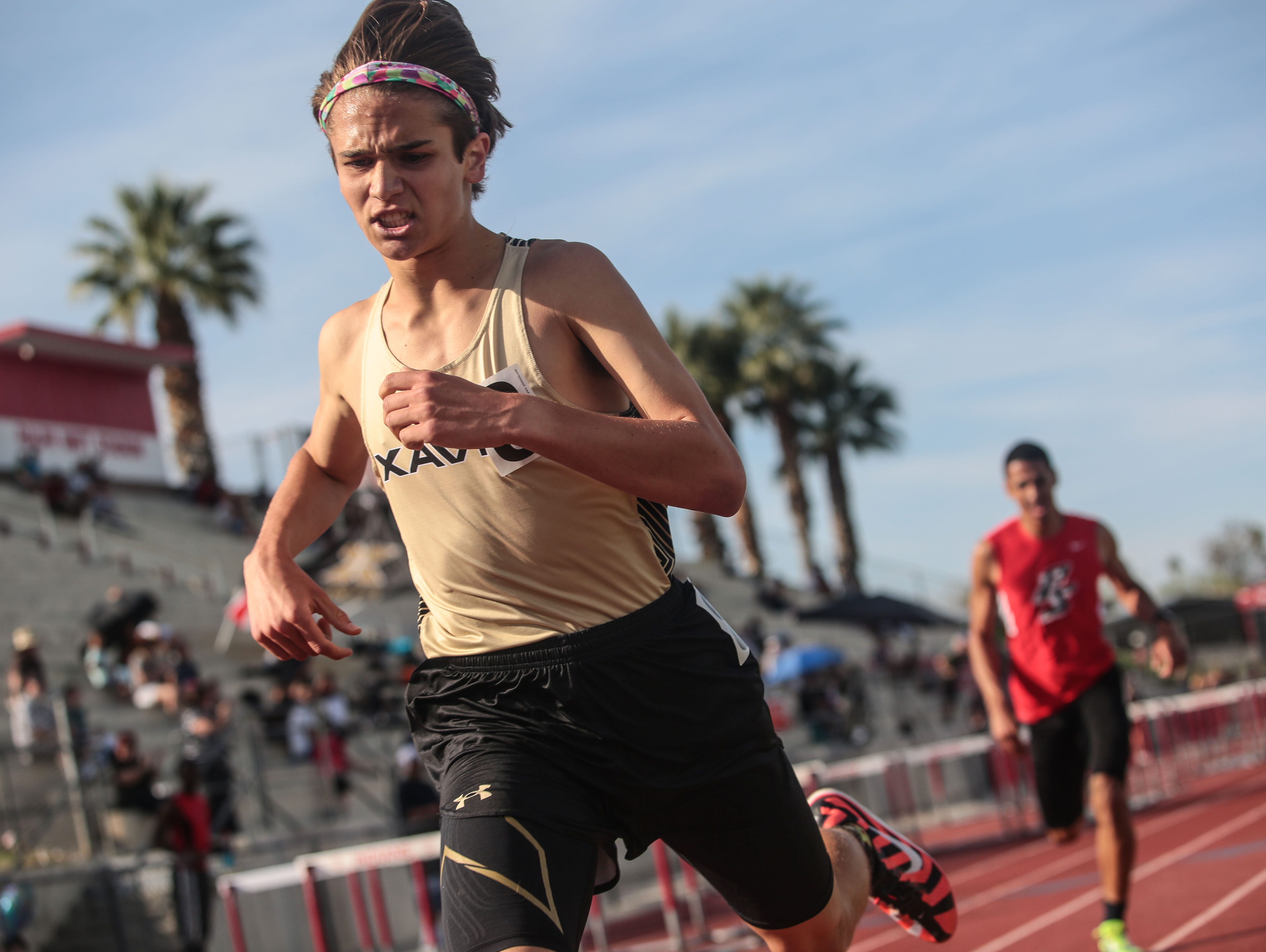 Xavier's Michael Brannier crosses the line first in the boys varsity 1600m race followed by Palm Springs' Kiviok Hight on Thursday, March 16, 2017 in Palm Springs.